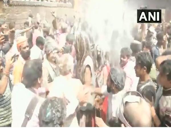 People at Varanasi's Manikarnika Ghat smear pyre ash on each other to celebrate Holi. Photo/ANI
