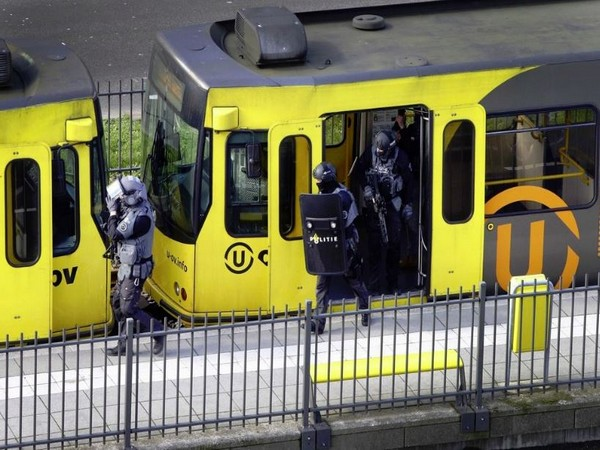 Police search a tram after a gunman opened fire in Utrecht on Monday.
