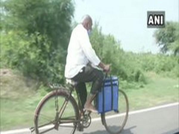 Dr Ramchandra Danekar on the way to a village in Chandrapur, Maharashtra on Friday. [Photo/ANI]