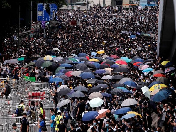 Protestors blocking a main road in Hong Kong on June 12 last year.