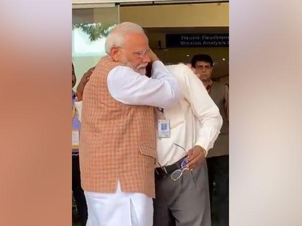 PM Modi hugs ISRO chief K Sivan in Bengaluru on Saturday morning. (Photo/ANI)