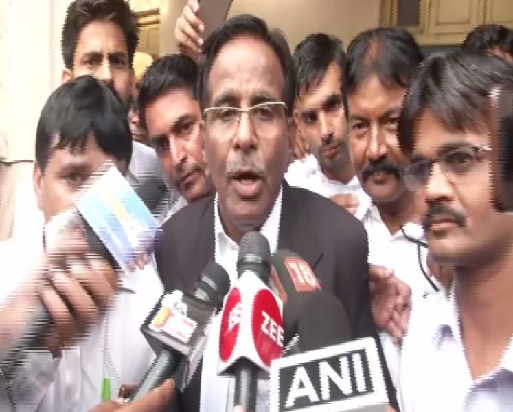 Advocate Hukam Chand Sharma speaking to reporters in Alwar on Wednesday. Photo/ANI