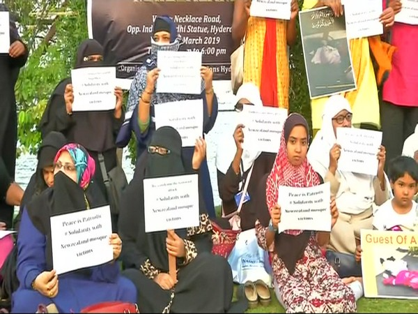 Women holding posters in Hyderabad on Saturday.