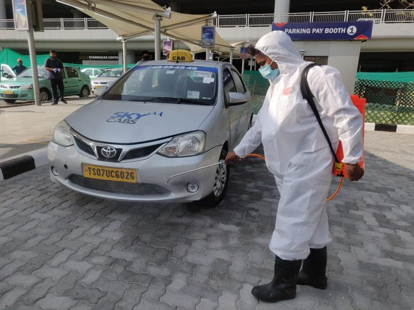 Designated taxi sanitisation personnel sanitising the taxi at Hyderabad Airport on Monday. Photo/ANI