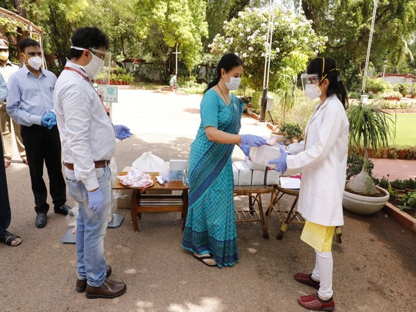 Jayanthi Mallya, President of SCRWWO, distributing safety kits to Paramedical staff in Hyderabad on Saturday. (Photo/ANI)