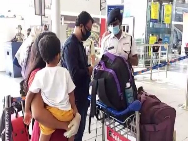 Passengers enquire about the flights at Hyderabad Airport on Monday. Photo/ANI