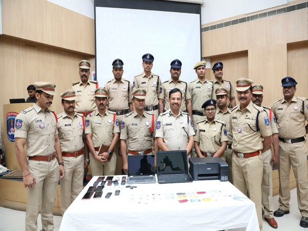 Members of the Cyberabad cyber crime wing with the things seized from the members of the online fraud ring. (Photo/ANI)