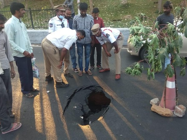 A portion of a busy road caved in near TRS Bhavan in Banjara Hills here on Monday
