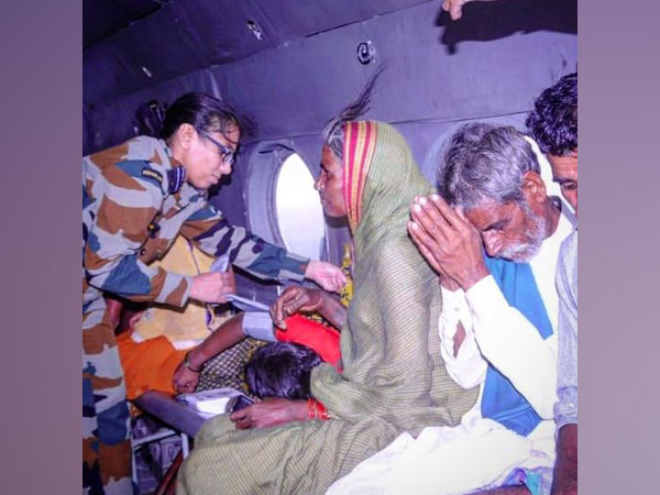 People rescued by IAF onboard helicopter. (Photo/ANI)