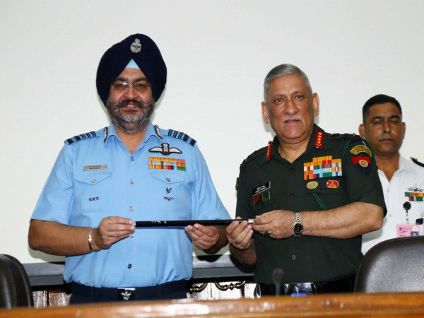 IAF Chief BS Dhanoa handing over the baton to the new Chairman, COSC, General Bipin Rawat in New Delhi on Friday (Picture Credit: Defence Ministry)