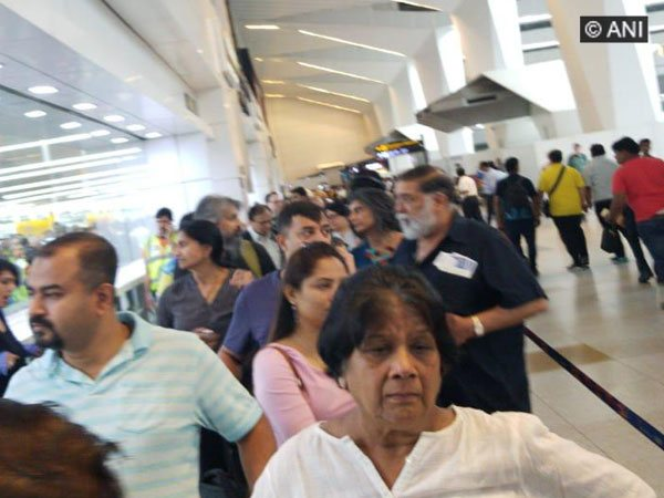 Passengers stranded at IGI Airport after immigration servers went downon Monday Pnoto/ANI