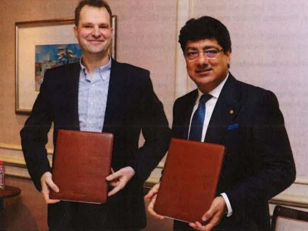 Craps (left) and Chhatwal after signing the agreement in Mumbai