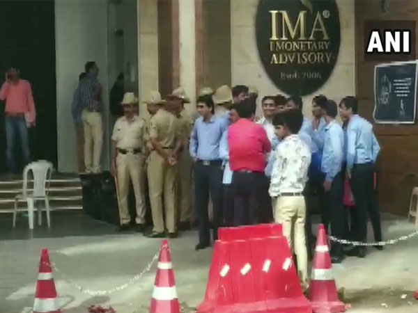 SIT sleuths at IMA Jewels head office in Bengaluru. (File Pic)