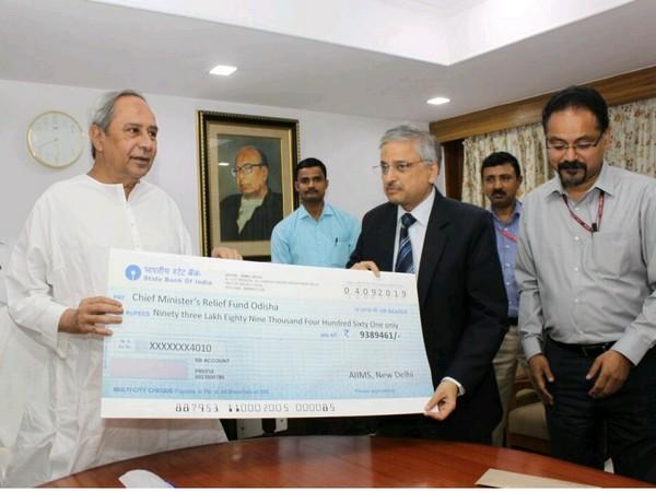 Odisha Chief Minister Naveen Patnaik with AIIMS Director Randeep Guleria