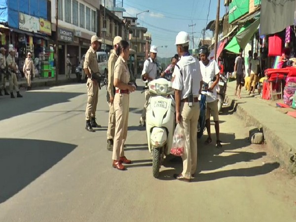 A visual of Manipur Police giving counseling to the people without helmets in Imphal on Sunday. Photo/ANI