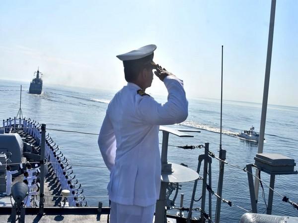 Commanding Officer of INS Tarkash Captain Sathish Vasudev's returning salute to Russian President Vladimir Putin. (Photo/ANI)