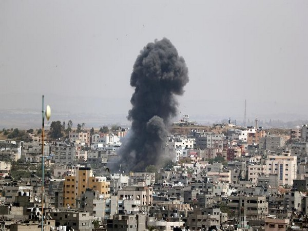 Smoke rises from a building in Gaza after Israeli airstrikes.