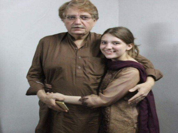 Human rights defender Idris Khattak with his daughter Talia Khattak (Photo courtesy: Amnesty International)