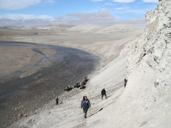 Team of Western planetary scientists, led by Gordon Osinski, exploring melt rock at Haughton impact crater in Nunavut (Image Credit: Gordon Osinski)