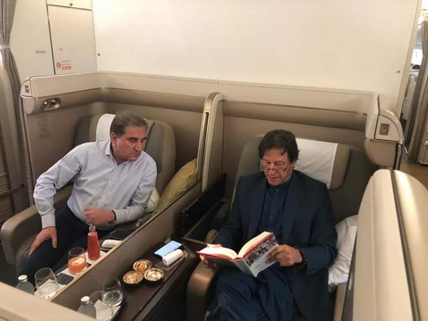 Pakistan Prime Minister Imran Khan and Foreign Minister SM Qureshi onboard the commercial flight on Saturday. (Photo Credits: PTI Twitter)