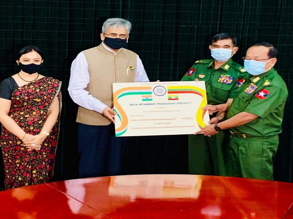 Indian Ambassador to Myanmar Saurabh Kumar on Friday gave USD 5 million cheque to Lt-Gen Ye Aung, Minister for Border Affairs. Photo/ANI