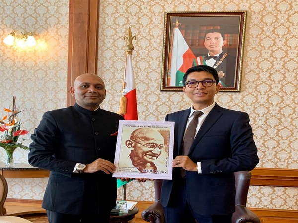 Indian Ambassador to Madagascar and President of Madagascar  unveil a postal stamp issued by the Madagascar Post to commemorate 150th birth anniversary of Mahatma Gandhi