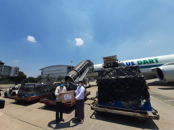 Ambassador of India to Myanmar, Saurabh Kumar handing over medical supplies to Myanmar's Ministry of Health and Sports at Yangon Airport on Wednesday.
