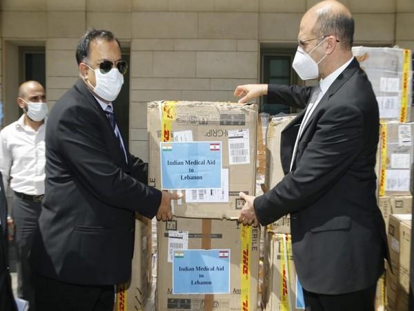 Indian Ambassador to Lebanon Suhel Ajaz Khan handing over the PPE kits to Lebanon Minister of Public Health Hamad Hassan.