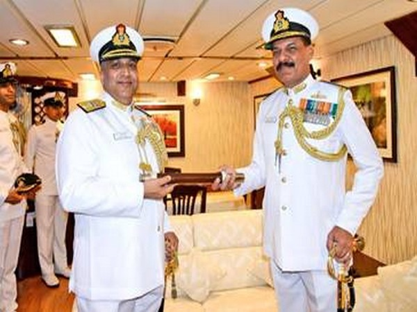 Rear Admiral Suraj Berry taking charge from Rear Admiral Dinesh K Tripathi, AVSM, NM at a ceremony at the Naval Base, Pune, on Saturday. (Photo courtesy: PIB)