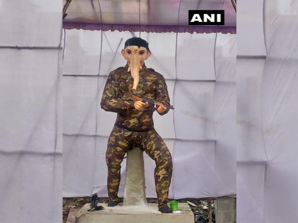 an idol of Ganesha that resembles army personnel
