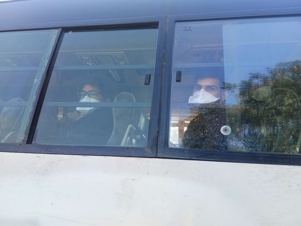 The bus carrying Indians who arrived from Wuhan on a special Air India flight on Saturday (Photo/ANI)