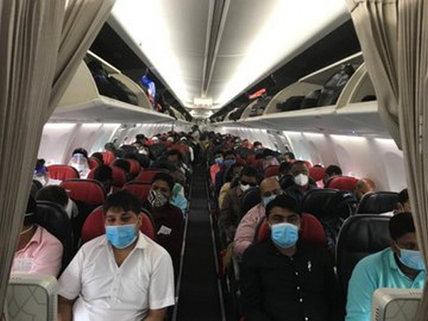 Indian nationals onboard the special Cotonou-N'Djamena-Istanbul-Delhi charter flight. (Photo credits: India in Nigeria Twitter)