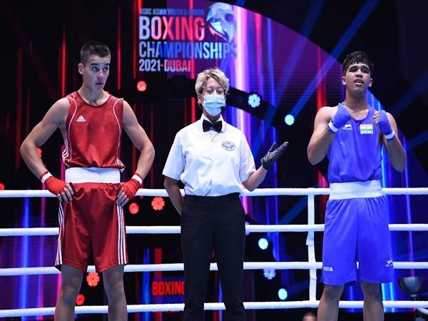 Gaurav Saini celebrates after winning bout (R)