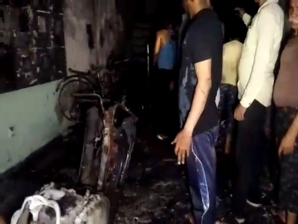 Vehicles charred in fire that broke out in a residential building in Indore on Thursday. Photo/ANI