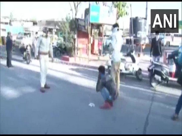 Amid COVID-19 lockdown, people found wandering unnecessarily on streets do sit-ups in Indore