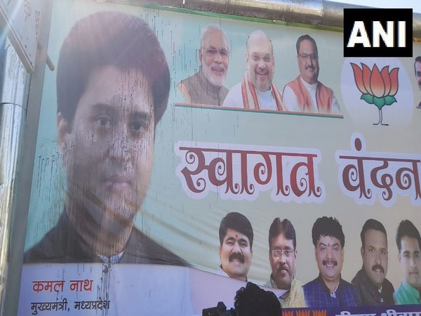 Ink thrown on BJP posters welcoming Scindia ahead of return to Bhopal. Photo/ANI