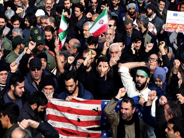 Demonstrators attend a protest against the killing of Iran's Quds Force leader Qassem Soleimani in a US air attack near Baghdad airport (Picture: Reuters)