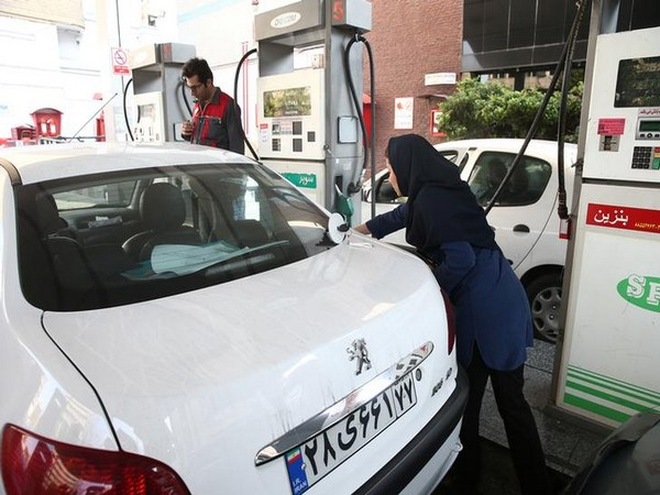 Iranians queued at petrol stations after fuel rationing and price hikes were announced on Friday