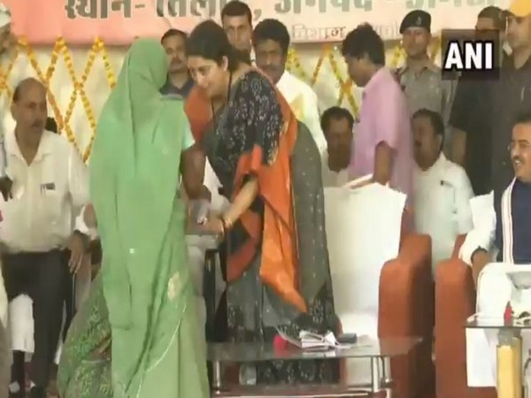 Union Minister Smriti Irani consoling a woman who fell down at her feet in Amethi on Saturday.