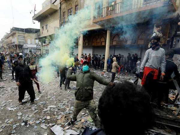 Iraqi protestors clash with security forces in Baghdad on Thursday.