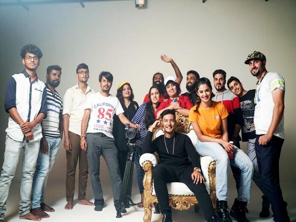 Ishviene, in white cap, with her team members of Ishkaa Studios