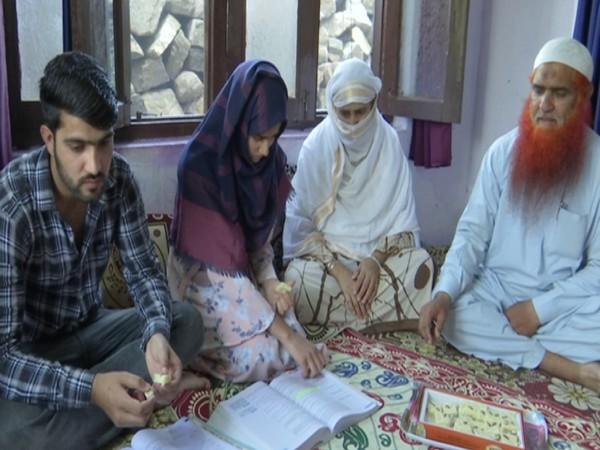 Aisha Bibi with her family. (Photo/ANI)