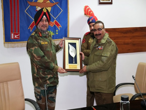 Director General of Police of Jammu Kashmir Police Dilbagh Singh Presenting momento to Lieutenant General Ranbir Singh in jammu on Tuesday Photo/ANI