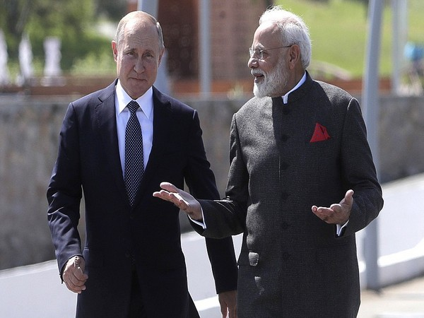 Russian President Vladimir Putin (L) and Prime Minister Narendra Modi (R) In Vladivostok on Wednesday
