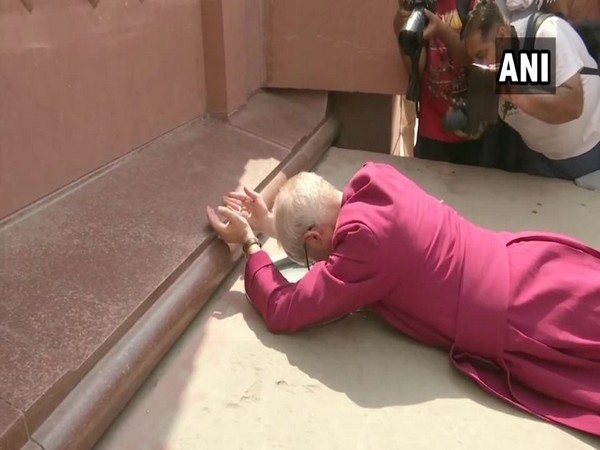 Archbishop of Canterbury, Justin Welby lies on floor during his visit to Jallianwala Bagh in Amritsaron on Tuesday. Photo/ANI