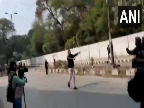 Man brandishes gun in Jamia area in New Delhi. Photo/ANI