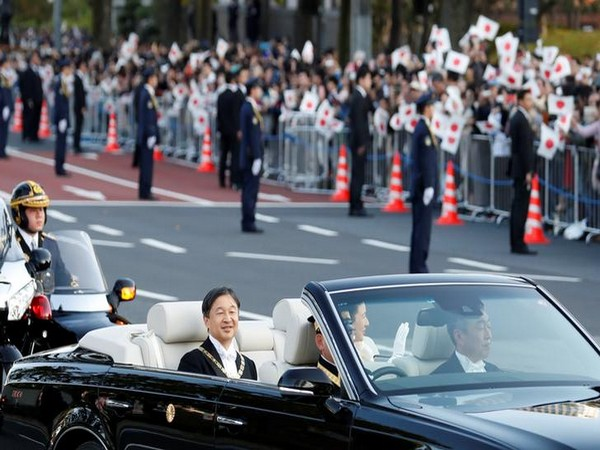 Japan's Emperor Naruhito and Empress Masako ride in a car during their royal parade to mark the enthronement of new Japanese Emperor in Tokyo on Sunday