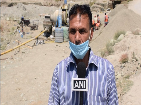 A resident of Shopian district present at the construction site speaking to ANI on Monday. (Photo/ANI)