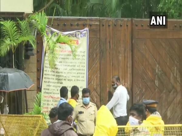 Brihanmumbai Municipal Corporation officials put a banner outside 'Jalsa'. Photo/ANI