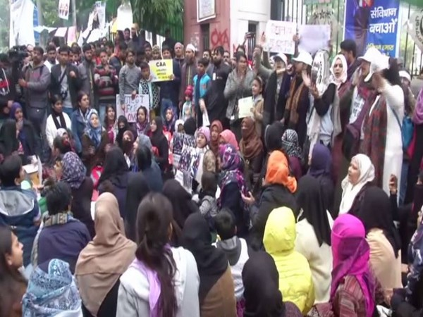 Students and locals gather for protest against CAA near Jamia University campus on Saturday. Photo/ANI